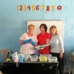 Three volunteers at the dental clinic in El Hato