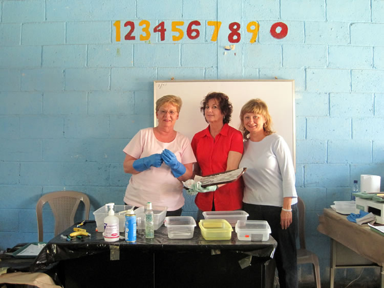 Three volunteers at the dental clinic in El Hato