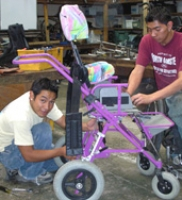 Transitions team working on a custom walker.